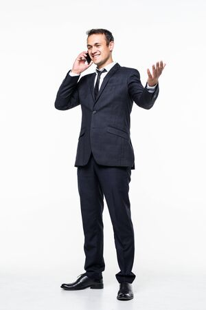 young business man walking and talking on phone while looking to a side on white background