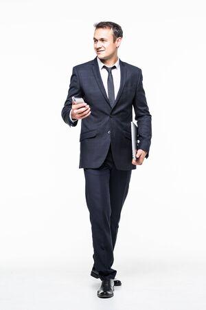 full length of Successful businessman holding smart phone isolated on white Reklamní fotografie