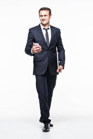 full length of Successful businessman holding smart phone isolated on white Zdjęcie Seryjne