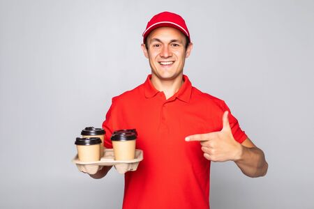 Happy delivery man with coffee isolated on white background