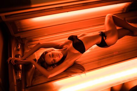 Beautiful woman have tanning skin treatment in modern solarium