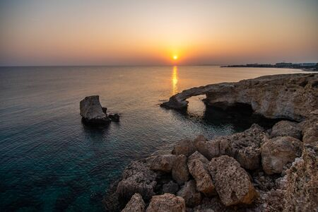 Ayia Napa, Cyprus with beautiful love rock bridge on mediterranean sea at sunset