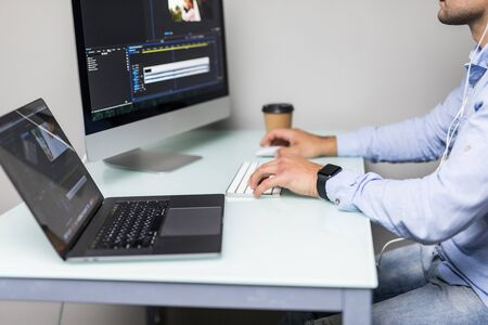 Confident Man Video Editor Works with Footage in Creative Office