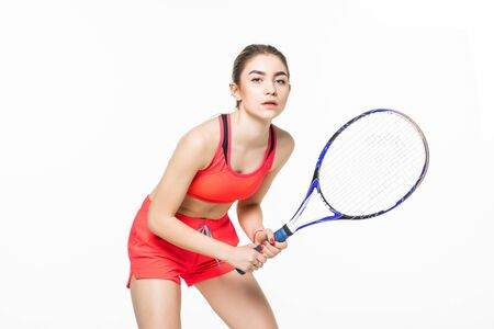 Image of a beautiful young sport fitness woman tennis player make exercises isolated over grey wall background. Imagens