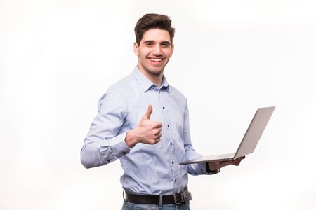 businessman with laptop computer showing his thumbs up. Isolated on white Standard-Bild