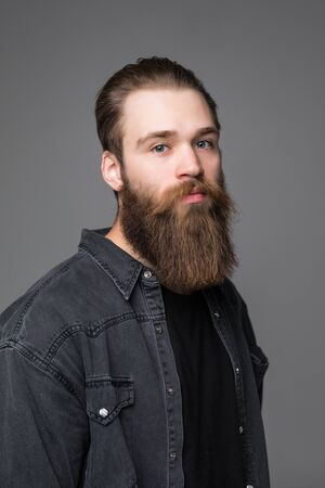 Portrait of handsome bearded man in checkered shirt