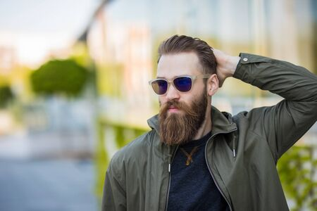 Young bearded man with sunglasses on the street