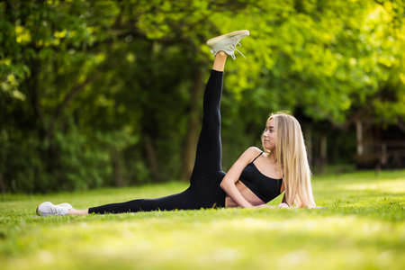 Healthy young woman stretching before fitness and Exercise in park
