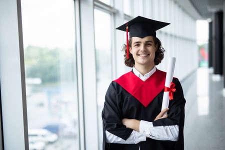 Graduate male student - graduation concepts. Portrait on his graduation day. University.