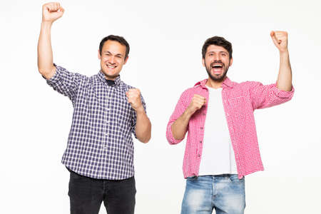 Portrait of a two cheerful men celebrating isolated over white background