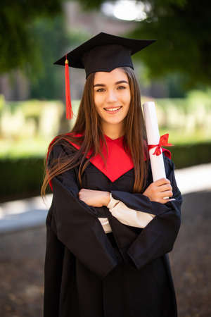 Woman portrait on her graduation day. University. Education, graduation and people concept. Stock fotó