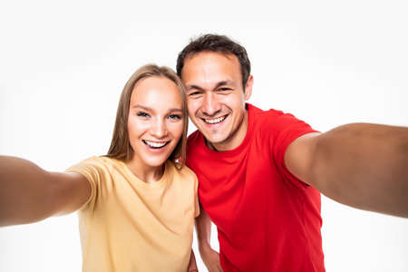 Portrait of young funny couple making selfie