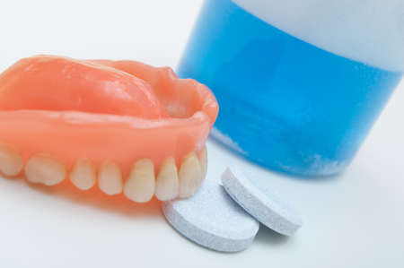denture: Denture with cleaning tablets and  water glass