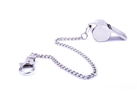 stainless steal: the beautiful world cup whistle with stainless steal ornamental chain on the white background
