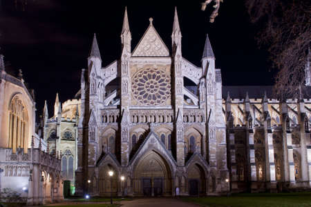 the northern facade of westminster abbey illuminated