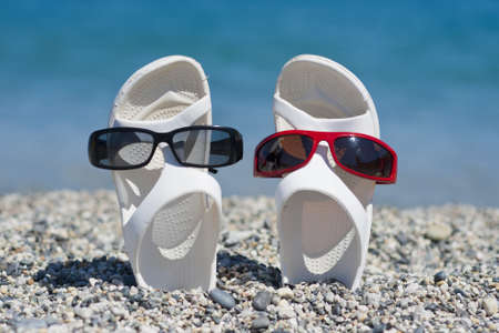 two white sandals dressed with different sunglasses Stock Photo - 15437163