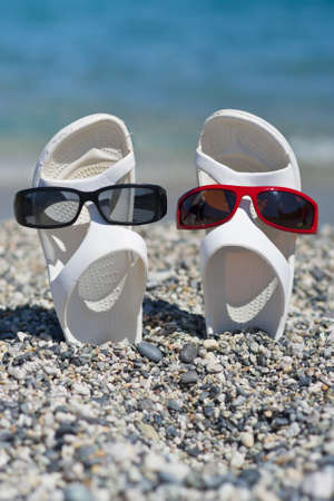 two white sandals dressed with different sunglasses