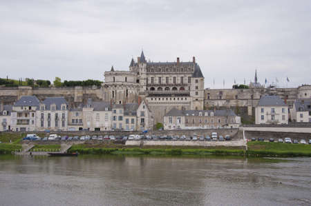 The chateau dAmboise and the village on the river Loire, seen from the opposite bank