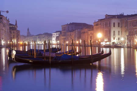 gondolas and buildings in the light of dawn in the canal grande in venezia photo