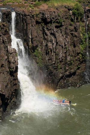 on a dinghy under the iguazu falls