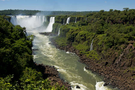 the magnificent garganta del diablo at the iguazu falls, one of the seven natural wonders of the world Фото со стока