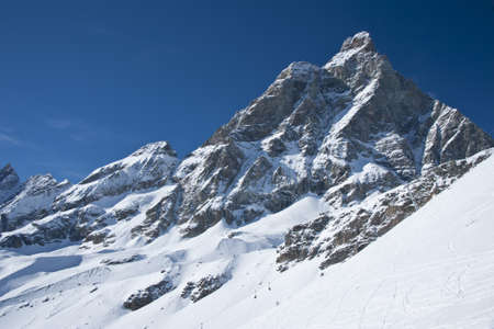 the peak of the Matterhorn seen from the valley of Cervinia in Val dAosta Stock Photo