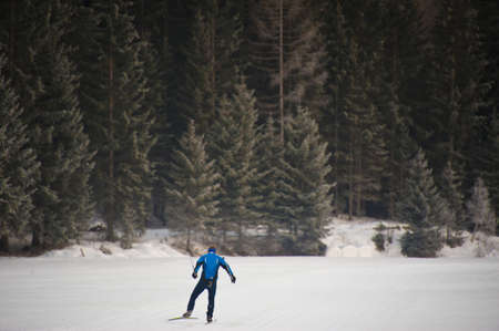 sudtirol: man cross-country skiing in the valley of pfitsch in sudtirol