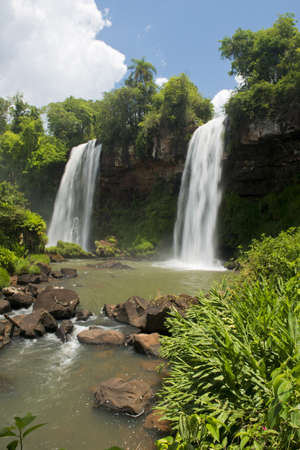 Two waterfalls at the Iguazu Falls, one of the seven natural wonders of the world, between Brazil and Argentina