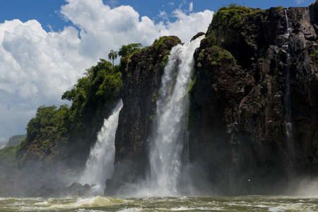 the magnificent  iguazu falls, one of the seven natural wonders of the world, between Argentina and Brasil. Seen from a dinghy on the Parana River