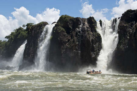 the magnificent garganta del diablo at the iguazu falls, one of the seven natural wonders of the world, between Argentina and Brazil