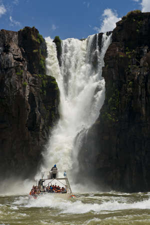 the magnificent garganta del diablo at the iguazu falls, one of the seven natural wonders of the world, between Argentina and Brazil photo