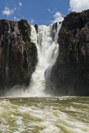 natural wonders: the magnificent  iguazu falls, one of the seven natural wonders of the world, between Argentina and Brasil. Seen from a dinghy on the Parana River