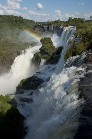 the magnificent waterfalls of Iguazu, one of the seven natural wonders of the world, between Argentina and Brazil. photo