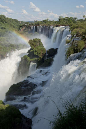 the magnificent waterfalls of Iguazu, one of the seven natural wonders of the world, between Argentina and Brazil.