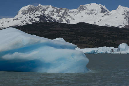 Spectacular blue iceberg floating on the Lake Argentino in the Los Glaciares National Park, Patagonia, Argentina. photo