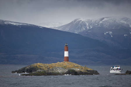 Lighthouse Les Eclaireurs on an islet in the Beagle Channel, near Ushuaia in the Tierra del Fuego Stock Photo