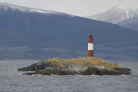 tierra: Lighthouse Les Eclaireurs on an islet in the Beagle Channel, near Ushuaia in the Tierra del Fuego Stock Photo