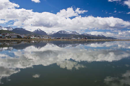 Specular reflection of the cityscape of Ushuaia in  Tierra del Fuego, Argentina Stock Photo