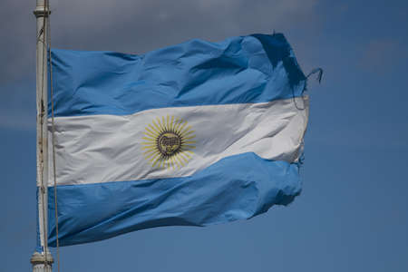 argentinian flag: Argentinian flag waving in the wind, against the blue sky
