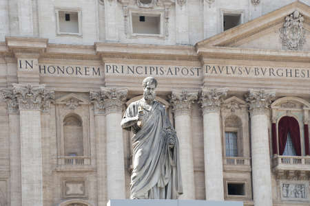Statue facing the facade of Saint Peter's Basilica, a masterpiece of italian renaissance architecture, situated in the center of Rome,. Seat of the Pope and principal landmark of the Vatican
