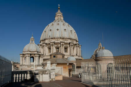 The dome of Saint Peter's Basilica, a masterpiece of italian renaissance architecture, situated in the center of Rome,. Seat of the Pope and principal landmark of the Vatican Stock Photo - 18306356