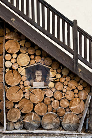 burl wood: lumber ready to be burned under a wood ladder Stock Photo