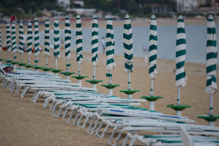 Row of beach umbrellas in a beach resort of Marcelli di Numana in Marche