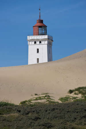 Lighthouse on a sand dune in Rubjerg Knude in Denmark Stock Photo
