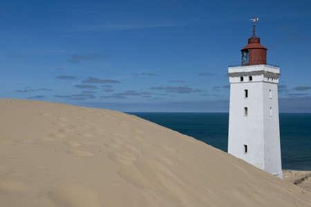 sand dune: Lighthouse on a sand dune in Rubjerg Knude in Denmark Stock Photo