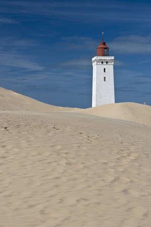 jutland: Lighthouse on a sand dune in Rubjerg Knude in Denmark Stock Photo