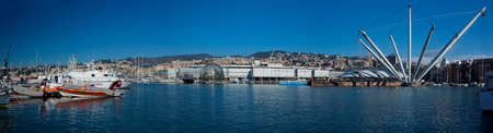 The ancient harbour of Genoa in Liguria, with the acquarium and the Bigo built by the architecture Renzo Piano for the Colombiane in 1992  Stock Photo