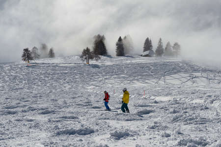 Mist on the ski slopes of Carezza, Trentino South Tyrol Stock Photo