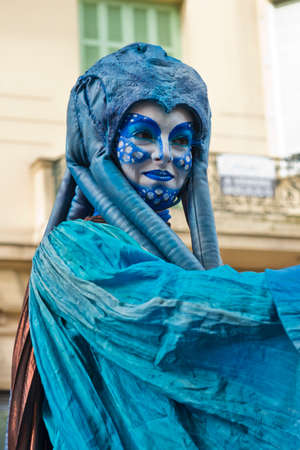 MENTON, FRANCE - 2 MARCH 2014 - Unidentified woman masked during the parade of the Lemon Festiva