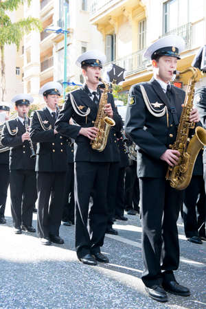 menton: MENTON, FRANCE - 2 MARCH 2014 - Unidentified players marching with the band in the Lemon Festival Parade